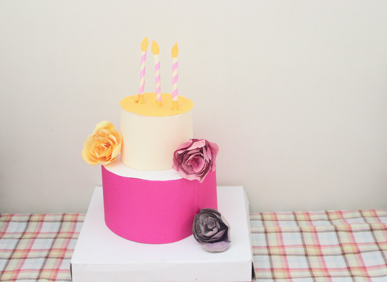 paper crafted cake with paper roses